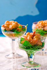 salad - cocktail with shrimps, avocado and arugula