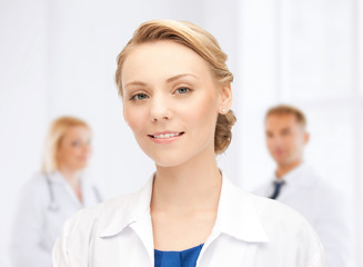 smiling young female doctor in hospital