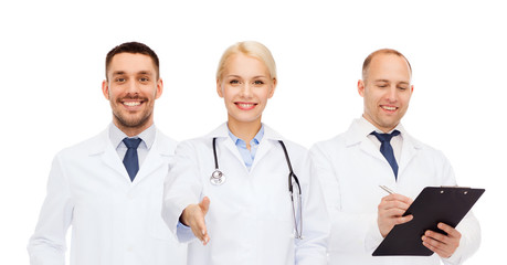 group of doctors making handshake gesture