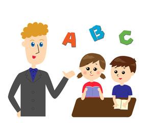英語を教える外国人の先生と子どもたち