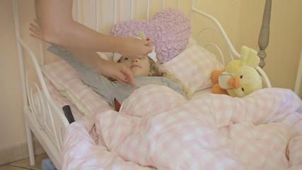 Little girl sick in bed measure flu long