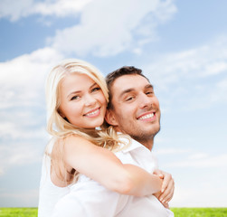 happy couple having fun over poppy flowers field