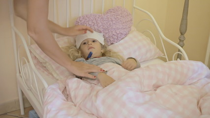 Little girl sick in bed measure flu short