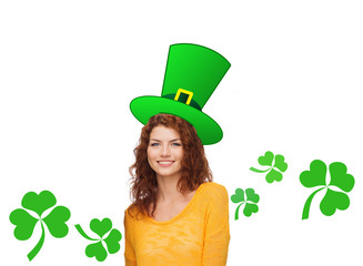 smiling teen girl in green top hat with shamrock