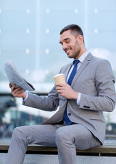 young businessman with coffee and newspaper