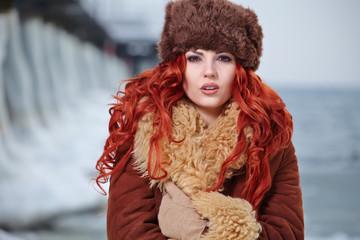 Young woman winter portrait. Shallow dof.