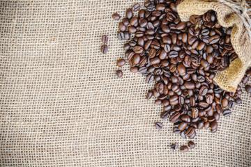 coffee bean in sack bag on burlap background