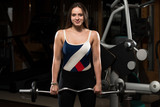 Woman Doing Heavy Weight Exercise For Trapezius poster