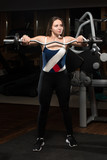 Young Woman Doing Exercise For Trapezius poster