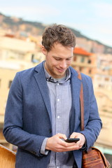 Smart phone young urban businessman on smartphone