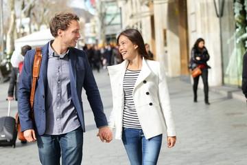 Urban modern professionals couple walking