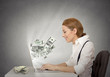 woman using her laptop computer making money grey background