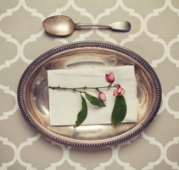 Vintage silver platter and spoon place setting