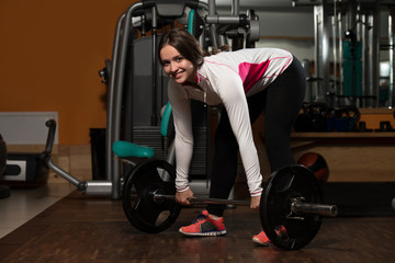 Young Woman Doing Deadlift For Back