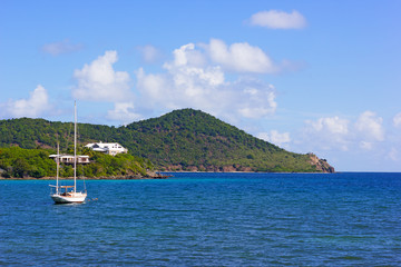 Beautiful yacht near the tropical islands in Caribbean Sea.