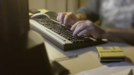 Man PC keyboard typing routine