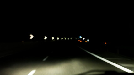 Night driving POV highway blurred