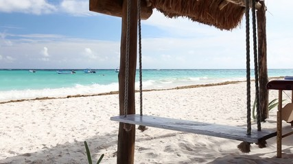 Beautiful tropical beach with a seesaw, Cancun, Mexico