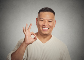 handsome, happy, smiling, excited man employee giving OK sign