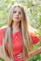 Portrait of a beautiful girl in spring in a sunny day
