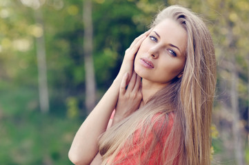 Portrait of beautiful young woman in spring