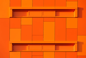 Orange wall of a modern apparment building.