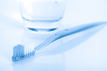 tooth brush in glass on white background
