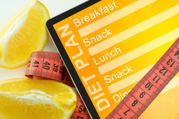 Tablet with diet plan and measuring tape