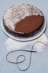 Festive Cake with chocolate glaze served with white crockery