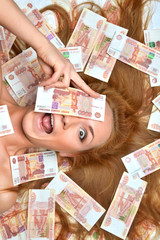 woman lying down with many cash money five thousand russian rubl