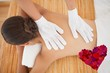 Composite image of beautiful brunette enjoying a back massage