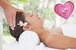 Composite image of beautiful brunette enjoying a head massage