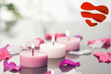 Composite image of lighted candles and petals