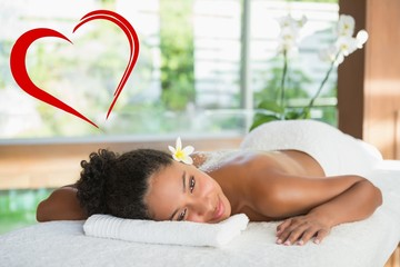 Gorgeous woman lying on massage table with salt treatment