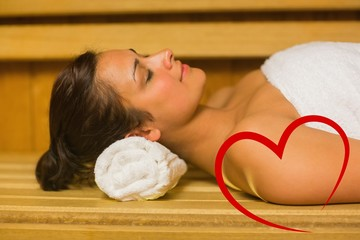 Composite image of peaceful brunette relaxing in a sauna
