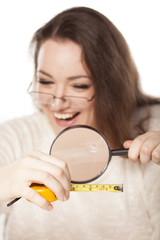 woman laughed at the size shown on the measuring tape