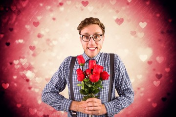 Composite image of geeky hipster holding a bunch of roses