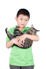 boy hugging with his cute tiger cat isolated on white background