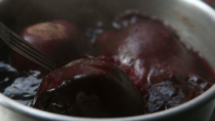 cooked boil red beetroot take by fork