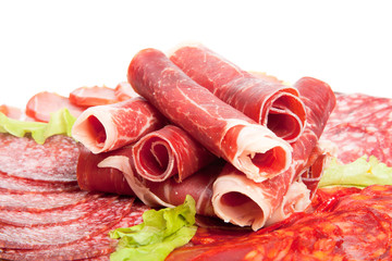 Slices of different kinds of meat with green salad