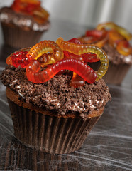 Muffin with cream in wafer crumbs and jelly worms