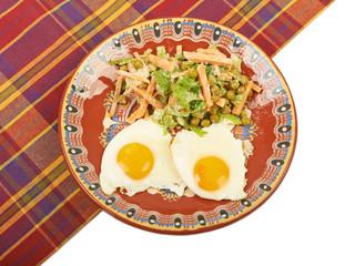Вreakfast of scrambled eggs and lettuce on a plate