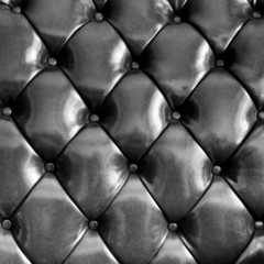 Close up black luxury buttoned leather