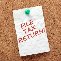 Reminder to File Tax Return pinned to a notice board