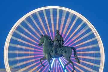 Statue of King Louis XIV by night