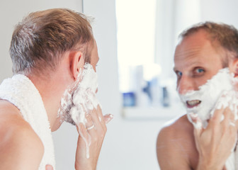 Man with shaving foam on face