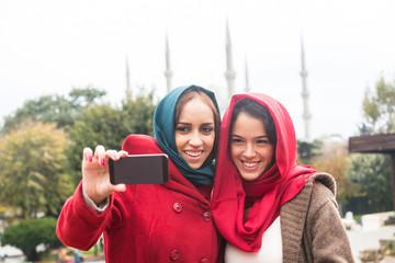 Arab Women Wearing Veil Taking Selfie in Istanbul