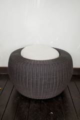 A modern design of rattan stool with white cushion