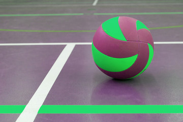 Green and purple ball on court at break time