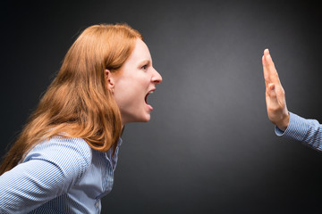 Angry Woman Shouting at a Hand